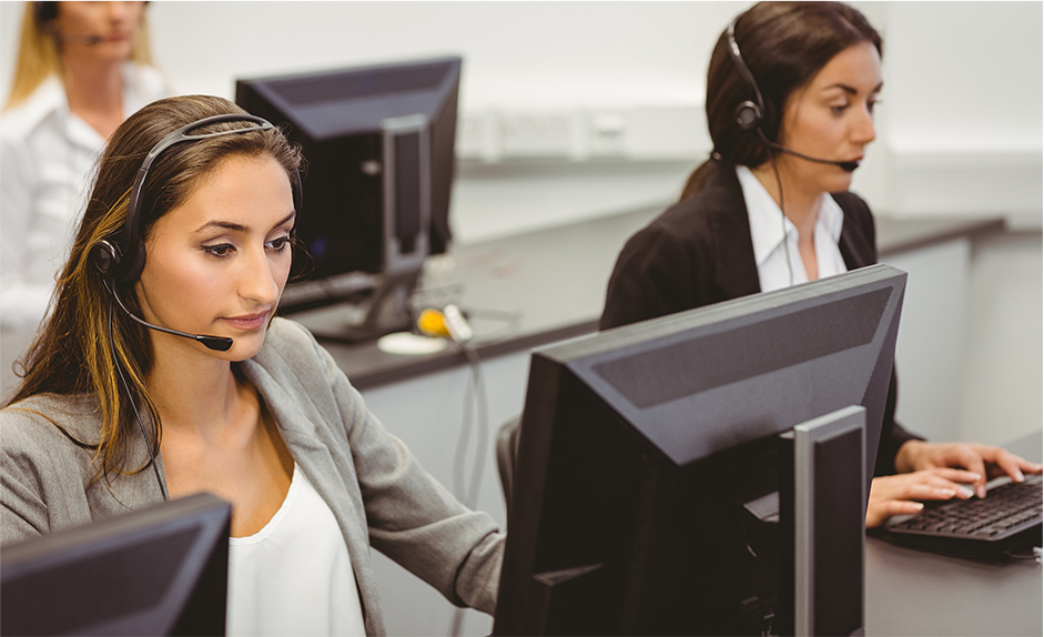Woman on headset at call center